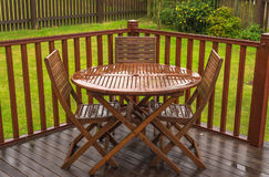 Rain Soaked Garden Table & Chairs royalty free stock image