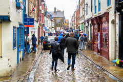 Rain soaked tourists, Church Street, Whitby. 3rd September 2016. Stock Photography