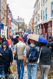Rain soaked tourists, Church Street, Whitby. 3rd September 2016. Royalty Free Stock Photography
