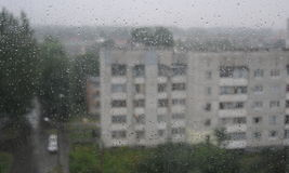 Through a rain splatter home window Royalty Free Stock Photos
