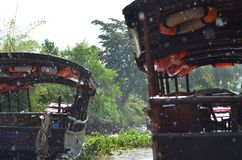 Rain-splattered traditional boats in the Vietnamese jungle. Royalty Free Stock Photo