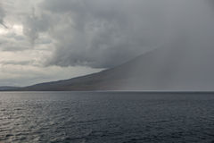 Rain Squall Over Volcano Stock Photography