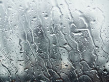 Rain steams on the window. Pattern of water steams on window glass during the rain, from inside Stock Photo