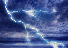 Rain storm backgrounds with lightning in cloudy weather Royalty Free Stock Images