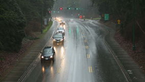 Rain Storm, Commuter Traffic. Commuter traffic through the Stanley Park Causeway during a heavy rain storm. Vancouver, BC., Canada stock footage