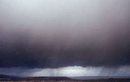 Rain storm. Fantastic views of the dramatic and cloudy skies. Stock Photos