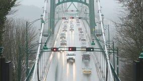 Rain Storm, Lions Gate Bridge. Commuter traffic on the Lions Gate Bridge during a heavy rain storm. Vancouver, BC., Canada stock footage