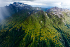 Rain storm moves over a green mountain landscape in Alaska Royalty Free Stock Image