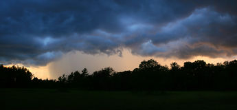 Rain Storm Panorama. Evening rainstorm with a bit of a sunset Royalty Free Stock Images