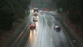 Rain Storm, Stanley Park, Vancouver. Heavy traffic drives through the pouring rain stock video