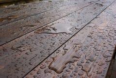 Rain. Storm water wet drop wood table water cold fresh nature natural season Royalty Free Stock Photo