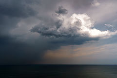 Rain and stormy cloud over sea. Rain and stormy cloud over the sea Stock Images