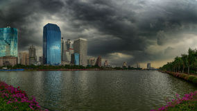 Rain and stormy clouds over cityscape, Bangkok, Royalty Free Stock Image