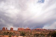 Rain Streaks Clouds Above Rock Formations Utah Juniper Trees Stock Photo