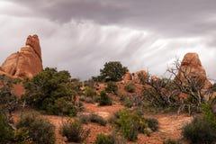 Rain Streaks Clouds Rock Formations Utah Juniper Trees Royalty Free Stock Images