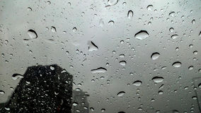 Rain on the street,. In the city. Raindrops falling on a glass droplets Royalty Free Stock Photo