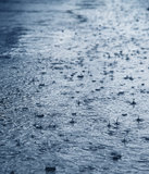 Rain on the a street macro Royalty Free Stock Photos