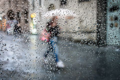 Rain in street and silhouette Royalty Free Stock Image