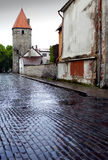 After the rain. Street and tower of a city wall. Old city. Tallinn, Estonia Royalty Free Stock Photo