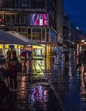 Rain on the streets of Belgrade. Wet streets. Colorful, shine city Stock Image