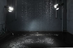 Rain in studio, lighting system. Rain in studio with black walls, lighting system for high-quality photography stock photography