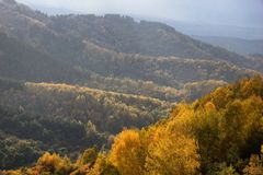Rain and sunlight in mountains Royalty Free Stock Photo