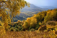 Rain and sunlight in mountains Royalty Free Stock Images