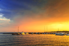 Rain and sunset over the yacht marina Stock Photo