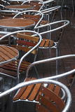 Rain and tables in town. Rain and wooden tables with chairs in town Royalty Free Stock Photo