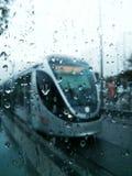 Rain and train. Jerusalem light rail train tram on rainy day Royalty Free Stock Photos