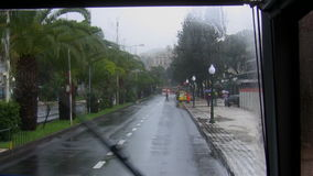 Rain in a tropical city. Tropical street view through the bus window on  a rainy day stock video footage