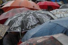 Rain umbrella with rain drops Stock Images