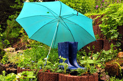 Rain umbrella rubber boots Stock Photography