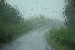 Through the rain into the unknown. Glass and rain. Through the rain into the unknown Royalty Free Stock Photos