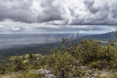 Rain in the Ural mountains. Gray clouds, rain wall, Ural Mountains Stock Photo