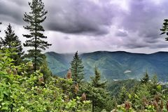 Rain In The Valley. A rain shower in the valley near Wallace, Idaho. View from across up in the mountains royalty free stock photography