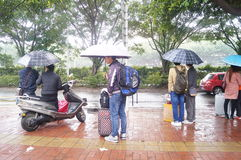 The rain waiting on bus home people. Spring Festival approaching, the bus in the rain waiting for the bus, people go home in Shenzhen, China royalty free stock images