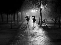 Rain walk. People walking under rain and fog Royalty Free Stock Image