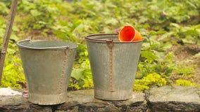 Rain Water Conservation in steel bucket stock video