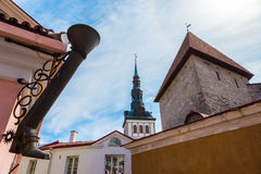 Rain water downspout as boot and view of old city of Tallinn Stock Photos