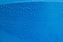 Rain Water droplets on blue fiber Stock Photo