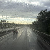 Rain water droplets on a car window Royalty Free Stock Photo
