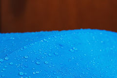 Rain Water droplets on  waterproof fabric. Rain Water droplets on blue fiber waterproof fabric with background Royalty Free Stock Photography