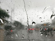 Rain water drops while driving Stock Images