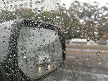 Rain water drops while driving Royalty Free Stock Photo