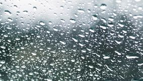 Rain, water drops on glass of the car stock video