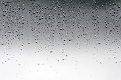 Rain water drops on the glass window Royalty Free Stock Photo