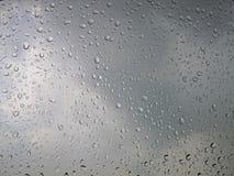 Rain water drops on gray sky background royalty free stock photo