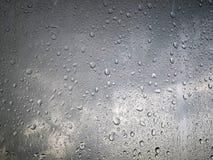 Rain water drops on gray sky background stock photo