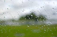 Rain water drops texture. Rain falling on a window pane Royalty Free Stock Images